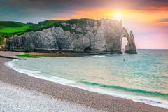 Breathtaking gravel beach and magical colorful sunset Etretat, Normandy, France stock photography