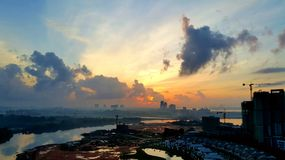 Breathtaking high angle view of Johor Bahru cityscape with cloud. High angle view Johor Bahru, Malaysia pastel orange morning sky. Sunrise view of cityscape with Royalty Free Stock Photography