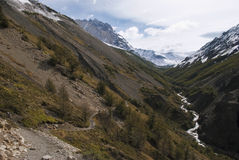 Breathtaking hike through pass in between rough mountain landscape. Royalty Free Stock Photography