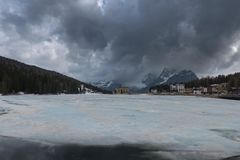 Misurina lake in winter covered with ice. Breathtaking landscape of Lake Misurina with Dolomites mountain in background, Italy. Panoramic nature landscape of royalty free stock photos