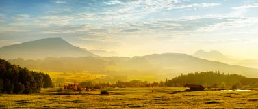 Breathtaking lansdcape of Austrian countryside on sunset. Dramatic sky over idyllic green fields of Anstrian Central Alps on autum Royalty Free Stock Image