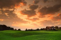 Breathtaking lansdcape of Austrian countryside on sunset. Dramatic sky over idyllic green fields of Anstrian Central Alps on autum Royalty Free Stock Images