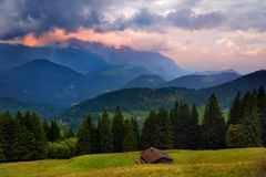 Breathtaking lansdcape of Bavarian mountains and forests on cloudy sunset. Scenic view of Bavarian Alps with majestic mountains in Stock Image