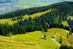 Breathtaking lansdcape of mountains, forests and small Bavarian villages in the distance. Scenic view of Bavarian Alps with majest. Ic mountains in the Royalty Free Stock Images
