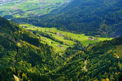 Breathtaking lansdcape of mountains, forests and small Bavarian villages in the distance. Scenic view of Bavarian Alps with majest. Ic mountains in the Stock Images