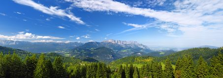 Breathtaking lansdcape of mountains, forests and small Bavarian villages in the distance. Scenic view of Bavarian Alps with majest Stock Image