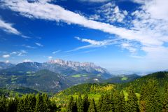 Breathtaking lansdcape of mountains, forests and small Bavarian villages in the distance. Scenic view of Bavarian Alps with majest Stock Photography