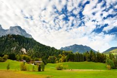 Breathtaking lansdcape of mountains, forests and small Bavarian villages in the distance. Scenic view of Bavarian Alps with majest Royalty Free Stock Photography