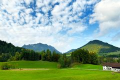 Breathtaking lansdcape of mountains, forests and small Bavarian villages in the distance. Scenic view of Bavarian Alps with majest. Ic mountains in the Stock Photos