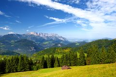 Breathtaking lansdcape of mountains, forests and small Bavarian villages in the distance. Scenic view of Bavarian Alps with majest. Ic mountains in the Royalty Free Stock Image