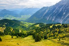 Breathtaking lansdcape of mountains, forests and small Bavarian villages in the distance. Scenic view of Bavarian Alps with majest. Ic mountains in the Stock Photo
