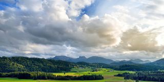 Breathtaking lansdcape of mountains, forests and small Bavarian villages in the distance. Scenic view of Bavarian Alps with majest Royalty Free Stock Images