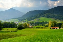 Breathtaking lansdcape of mountains, forests and small Bavarian villages in the distance. Scenic view of Bavarian Alps with majest Stock Images
