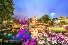 Free Breathtaking Magical Landscape In Tivoli Gardens In The Evening With Lake And Flowers. Copenhagen, Denmark. Exotic Amazing Places Royalty Free Stock Photo - 166691895