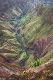 Breathtaking panorama of a steep gorge with winding riverbed and lush green vegetation on Delgadinho mountain ridge. Santo Antao, Cape Verde stock images