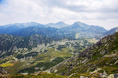 Breathtaking Retezat mountains in the Carpathians. Retezat mountains on a cloudy day Stock Images