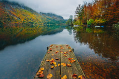 Breathtaking scenery of mountains, forests and lake with colorful reflections Stock Photos