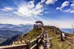 Tourist and hikers enjoy view on top of mountain royalty free stock photography