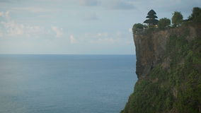 Breathtaking sight of high cliff with the temple on its top and endless Indian ocean. Panoramic scene of high mountain stock video