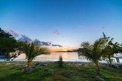 Breathtaking sunrise on desert exotic beach Royalty Free Stock Photos