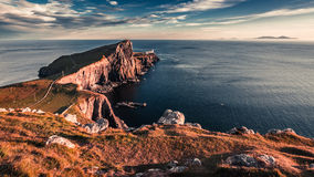 Breathtaking sunset at the Neist point lighthouse, Scotland, UK. Europe Royalty Free Stock Photography