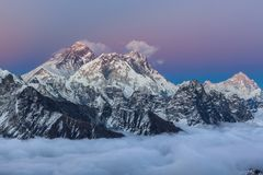 Breathtaking sunset over mount Everest summit. Breathtaking sunset over mount Everest summit with unbelievable sky gradient from blue to pink and violet, view stock image
