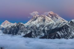 Breathtaking sunset over mount Everest summit. Breathtaking sunset over mount Everest summit with unbelievable sky gradient from blue to pink and violet, view stock images