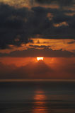 Breathtaking sunset in Tenerife, Canary Islands. Vertical shot of a winter sunset, with orange hues and dramatic intensity in a holiday destination desired for royalty free stock photos