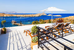 Breathtaking view on bay with beach and ships from balcony in Lindos, Rhodes, Greece. Royalty Free Stock Images
