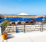 Breathtaking view on bay with beach and ships from balcony in Lindos, Rhodes, Greece. Royalty Free Stock Photo