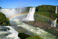 Breathtaking view of Devil`s Throat area of Iguazu Falls UNESCO World Heritage Site from Brazilian side with gorgeous rainbow stock images