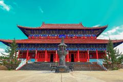 Breathtaking view of king`s palace of  Medicine Buddha old temple in Jingpo lake geopark with azure sky. Medicine Buddha old temple is an newly built landmark in Royalty Free Stock Image