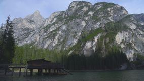 Breathtaking view of lake house and Dolomites, Pragser Wildsee in Italy, travel. Stock footage stock footage