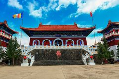Breathtaking view of Medicine Buddha old temple in Jingpo lake geopark with azure sky. Medicine Buddha old temple is an newly built landmark in Jingpo lake Royalty Free Stock Images