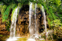 Breathtaking view of natural waterfall, lake cascade and water in deep tropical forest. Royalty Free Stock Images