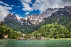 Breathtaking view of small town by the lake in Dolomites Stock Images