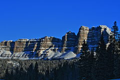 Breccia Cliffs on a sunny winter morning. Breccia Cliffs in the Absaroka range of the Central Rock Mountains on Togwotee Pass between Dubois and Jackson Hole Stock Image