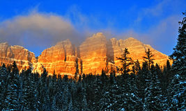 Breccia Peak and Cliffs and clouds glowing in the afternoon sun on Togwotee Pass Royalty Free Stock Photo
