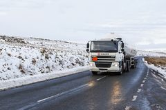 Road Haulage on country roads in icy weather. Brecon Beacons, UK: December 28, 2017: A Daf tanker truck drives on the A4059 in Wales. Calor Gas is a brand of Stock Photography