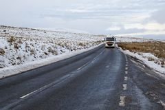 Road Haulage on country roads in icy weather. Brecon Beacons, UK: December 28, 2017: A Daf tanker truck drives on the A4059 in Wales. Calor Gas is a brand of Stock Photo