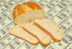 Bred. Bread Chunks On The One Hundred Dollar Bills Background Stock Photos