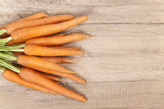 Bred carrots. On a wooden table Stock Photography
