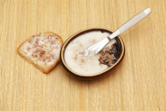 Bred with lard. Melted lard in a bowl. slice of bread Stock Photo