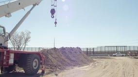 Bred panna av den near gränsen för konstruktionsplats arkivfilmer