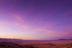 bred öppen soluppgång för öken Arkivbilder