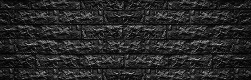 Bred svart textur för tegelstenväggen - stena kvartermurverkbakgrund royaltyfria foton