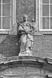 Sculpture of Lady Justice, goddess of Justice on an historic building, The Netherlands royalty free stock photo