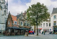 Breda, November 5th 2017: some locals walking past a old authent royalty free stock photography