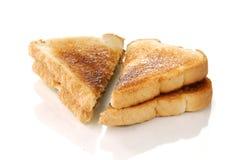 bredd smör på rostat bröd Fotografering för Bildbyråer