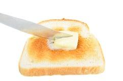 bredd smör på rostat bröd Arkivbilder